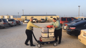 CARA volunteers wheel legal materials into Dilley family detention camp